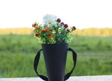 Bouquet of wild flowers at sunset in the field. stock photo