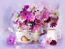Bouquet. Of wild flowers and tea cup stock photos