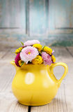 Bouquet of wild flowers in yellow jug Royalty Free Stock Images