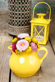 Bouquet of wild flowers in yellow jug Royalty Free Stock Photos