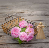 Bouquet of wild rose in vintage style and angel Royalty Free Stock Image