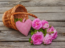 Bouquet of wild rose in vintage style on basket Royalty Free Stock Photography