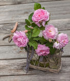 Bouquet of wild rose. In vintage style on a wooden  table Stock Photos