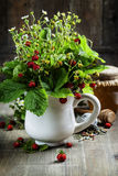 Bouquet of wild strawberry with herbal tea and honey Royalty Free Stock Images