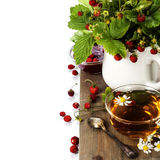Bouquet of wild strawberry with herbal tea and strawberry jam Stock Photos