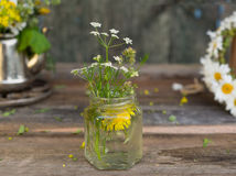 Bouquet of wild summer flowers in a glass jar Stock Photos