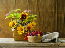 Bouquet of wildflowers. On a wooden background, rustic still life royalty free stock photography