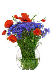 Bouquet of wildflowers - poppies and cornflowers in a glass vase isolated on white background, studio shot. Bouquet of wildflowers - poppies and cornflowers in Stock Photography