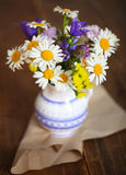 Bouquet of wildflowers on a rustic table Stock Photos