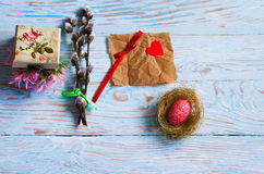 Bouquet willow branch and Easter eggs on a wooden table Stock Photo