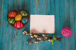 Bouquet willow branch and Easter eggs on a wooden table Stock Images