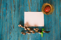 Bouquet willow branch and Easter eggs on a wooden table Royalty Free Stock Images