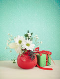 Bouquet of winter flowers with present Stock Photography