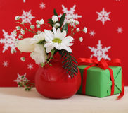 Bouquet of winter flowers with present Royalty Free Stock Photos