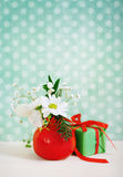 Bouquet of winter flowers with present Stock Photos