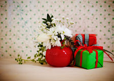 Bouquet of winter flowers with presents Royalty Free Stock Photo