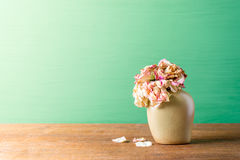 Bouquet of withered roses in vase Stock Image