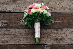Bouquet on the wooden background. Rain rustic Royalty Free Stock Photography