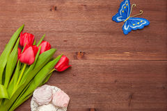 Bouquet on the Wooden Background. Tulips the Bouquet on the Wooden Background of the Board, the Spring yellow Blossoming Sheaf, Office on Wooden Structure Stock Images