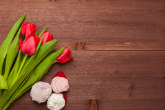 Bouquet on the Wooden Background. Tulips the Bouquet on the Wooden Background of the Board, the Spring yellow Blossoming Sheaf, Office on Wooden Structure Stock Photos