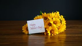 Bouquet of yellow big daisies. On a black background