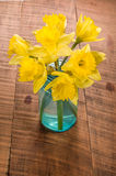Bouquet of yellow daffodil flowers in a jar Royalty Free Stock Images