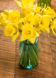 Bouquet of yellow daffodil flowers in a jar Stock Image