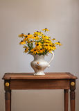 Bouquet of yellow daisy on antique Mahogany table. Royalty Free Stock Photos