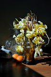 Yellow dried tulips in kitchen. The bouquet of yellow dried tulips at kitchen atmosphere stand in a glass vase Stock Photography