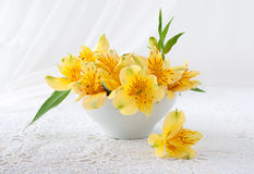 Bouquet of yellow flowers stands on a table Royalty Free Stock Photo
