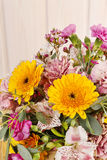 Bouquet of yellow gerbera daisies and pink carnations Royalty Free Stock Photos