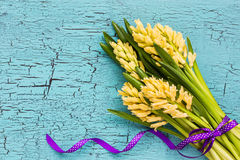 Bouquet of yellow hyacinths on bright blue background. Top view Royalty Free Stock Photography