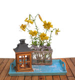 Bouquet of yellow lilies Citronella on blue tray next to an old Stock Photos