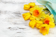 Bouquet of yellow narcissus and tulips on white wooden backgroun Royalty Free Stock Photos