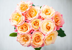 Bouquet of yellow-pink roses from above Stock Photo
