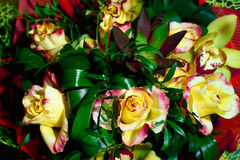 Bouquet of yellow with red roses with greenery from above Royalty Free Stock Photography