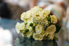 A bouquet of yellow roses with green buds. A Royalty Free Stock Photo