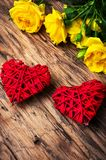Spring flowers and symbolic red hearts. Bouquet of yellow roses and symbolic red hearts.Postcard for Valentine Day Royalty Free Stock Images