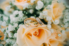 Bouquet of yellow roses and wedding rings Stock Photos