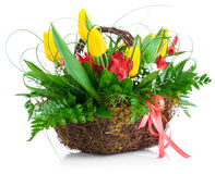 Bouquet yellow tulips basket green leaves Stock Images