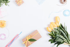 Bouquet of yellow tulips, boxes with gifts, ribbons and rope on Royalty Free Stock Photography