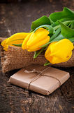 Bouquet of yellow tulips and chocolate Royalty Free Stock Images