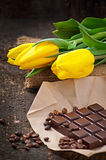 Bouquet of yellow tulips and chocolate Royalty Free Stock Photos