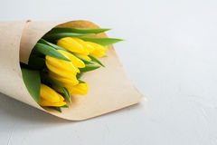 Bouquet Yellow Tulips Craft Paper Parcel for Woman Stock Images