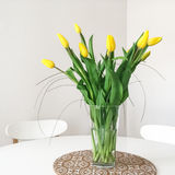 Bouquet of yellow tulips on a table Royalty Free Stock Photography