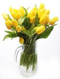 Bouquet of yellow tulips in a vase Stock Photo