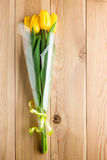 A bouquet of yellow tulips on wooden boards Stock Photography