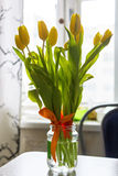 Bouquet of yellow tylips on table Royalty Free Stock Images