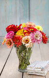 Bouquet of zinnia flowers and pile of vintage letters Royalty Free Stock Images