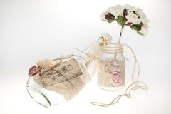 Bouquets and bottles on a white background. Stock Photo